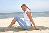 Sandy beach, woman, young, sitting, smiling, Side view, sea, summer,  Vacation, summer vacation, leisure time, 20-30 years, blond, leisurewear, towel,...
