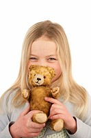 Girls, blond, teddy, portrait,    Series, 9-10 years, child, long-haired, plush animal, Kuscheltier, teddy bear, old, worn out, holding, shows, smilin...