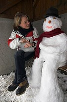 Bus stop, wood bank, snowman, Woman, young, gesture, watch, winters,   20-30 years, blond, winter clothing, sitting, stop, shelters, means of transpor...