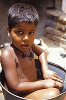 Child in a bucket. New Delhi, India