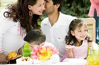 Parents with children 4-7, kissing