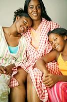 African sisters hugging