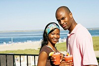 Young African couple having drinks