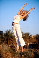 Woman jumping outdoors
