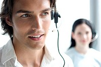 young man and young woman with headset on