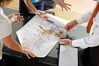 Coffee Pouring over Building Plan