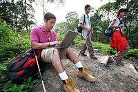 Hikers Using a Laptop