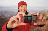 Hiker Taking Picture of Herself at Canyon