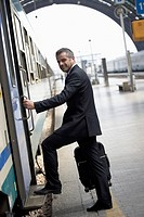 Businessman Boarding Train