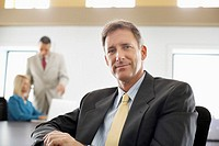 Confident Businessman in Conference Room