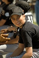Side profile of a baseball player smiling