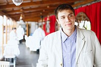 Young man standing in a restaurant