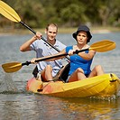 Portrait of a young man and a teenage girl kayaking