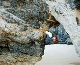 Couple sitting on rocks, Bermuda