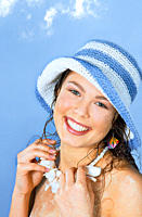 Woman wearing hat and smiling
