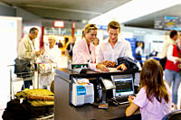 Couple at check in counter at airport