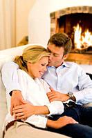 Couple hugging and kissing on sofa
