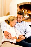 Couple hugging and smiling on sofa