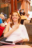 Young woman sitting in a restaurant and smiling
