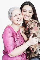 Portrait of a grandmother hugging her granddaughter