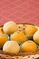 Close-up of Ladoos in a basket