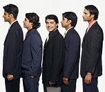 Portrait of a businessman standing in a row with his colleagues