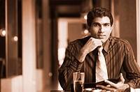 Portrait of a businessman sitting in a restaurant