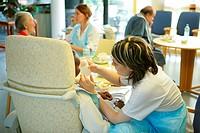 ELDERLYHOSPITALPATIENT<BR>PhotoessayatthehospitalofMeaux77,France SiteofOrgemont <BR>Canteen Anurse´aideisgivingadrinktoapatient