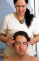 Man getting head massage from woman