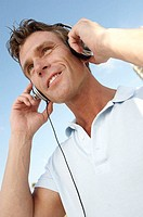 Low angle view of a mid adult man wearing headphones