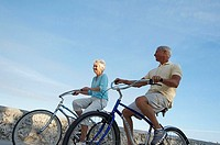 Low angle view of a senior couple riding bicycles
