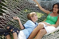 High angle view of a mother and her son lying in a hammock