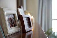 Photographs on fireplace mantel