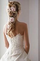 Bride wearing roses in her hair