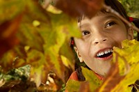 Girl looking up at leaves