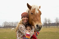 Mother and daughter hugging a horse