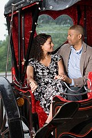 Couple sat in horse drawn carriage