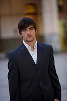 Man wearing a suit in courtyard