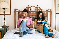 Couple reading on bed