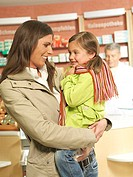 Pharmacy, mother, child, scarf, gaze-contact, carries smiles, semi-portrait, pharmacists, pharmacy, stores, business, salesroom, people, customers, wo...