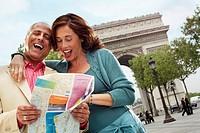 Couple Reading Map Outside Arc de Triomphe
