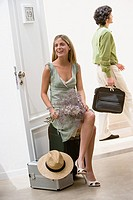Woman sat on suitcase