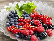 Fresh berries in glass bowl