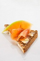 Toast triangle with salmon and melon