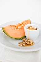 Yoghurt with muesli, honey and melon