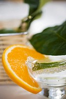 A glass of mineral water with slice of lime & orange