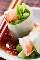 Vietnamese spring rolls with asparagus, shrimps, chili sauce