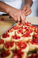 Filling vol-au-vent cases with strawberries
