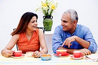 Mid adult couple sitting at the table and smiling