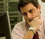 Hispanic businessman looking at computer
